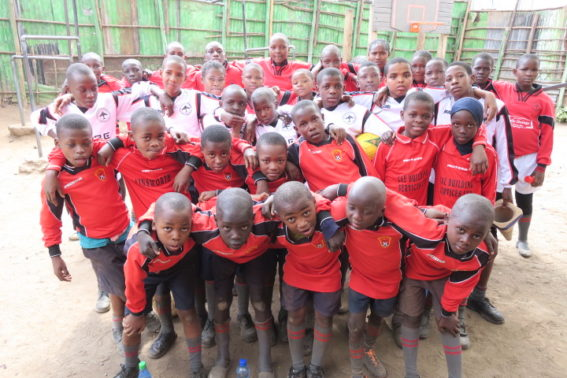 The TPFC kids in their new kits donated from the UK