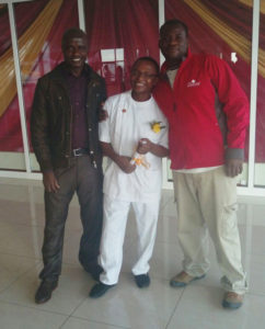 Teacher Philip and TPFP's Erick celebrating with Ombisa